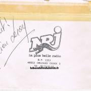 tampon NRJ Orléans avec un mot de l'animateur Julien Leroy en 1987